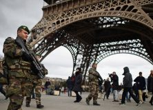 French troops patrol around the Eifel Tower on January 12, 2015 in Paris, France.